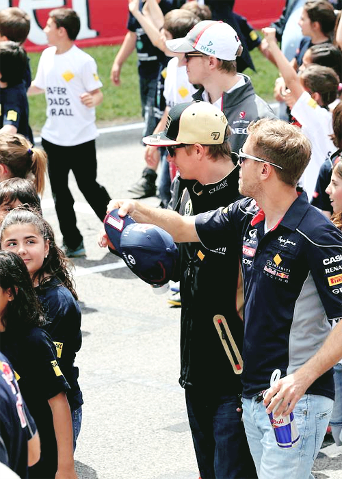 teamvettel:  2 things i love about this photo, a) Simi b) how Kimi is smiling at that little girl.