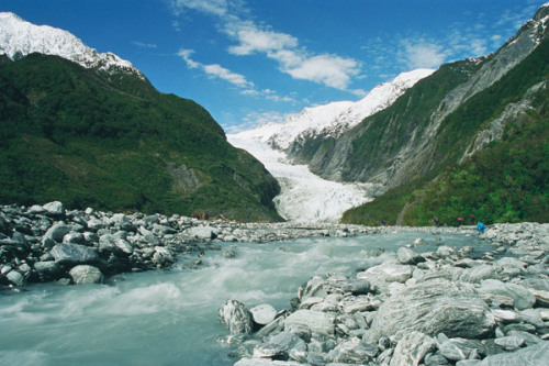 Today we will hike to Franz Josef Glacier on the wild West Coast of New Zealand.  Working on mom to take a helicopter trip to the top while I hike.  Let's see!  Yesterday we made a beautiful drive from Lake Wanaka.  Some of our highlights can be found here.  The past few days have been full of driving.  We are half-way up the South Island & I figure we have a few more days to Marlborough Sounds, where I think we will pause for a few days.  I'm thinking we will skip the North Island on this trip, as we are on beauty overload and mom needs some rest for a few days.   It's been so much fun getting into a rhythm with mom.  We know each other so well, yet we haven't spent 30 full days together since I was a baby.  Allot has changed since then.  Each of us our unique preferences, styles of music to listen to in the car, eating habits, sleeping schedules, energy cycles, endurance, thought patterns, etc.  That said, the strongest common element is our desire to find harmony and enjoy one another.  This takes patience, understanding and compassion.  It is a great opportunity for each of us to grow.  This is what relationships are all about anyway.  And we are learning allot.  That is not to say we are having a tough time getting along; actually quite the opposite.  I don't think I've laughed this much in years.  We joke like kids & reminisce about the ridiculousness of the past.  Oh, what fun!  Like two kids in a candy store, of which we have hit plenty along the way.  That is to say, holding onto my raw diet on these travels has not been too successful.  My mom keeps urging me to help her get healthy and then seduces me with delicious sweet delicacies along our journey.  Oh well, you can't win them all.  In the name of flow, I'm on the wave of a pleasure seeker   The journey continues.  Time to hike. Love & Light, RYAN!