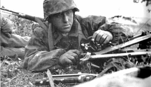 scooteraz:  That thousand yard stare,.Battle weary Waffen SS soldier,half aware of his surroundings,..