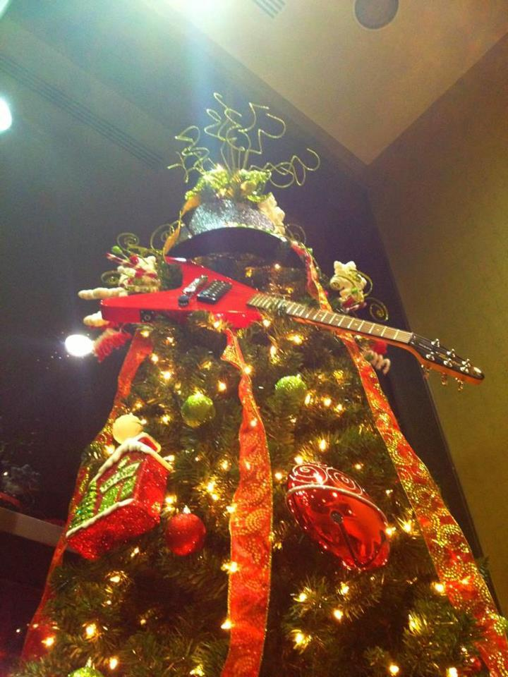 This tree must be so happy!   bungletastic:  Oh, Gibson Tree. Oh, Gibson Tree. How lovely are your Guitar Strings.