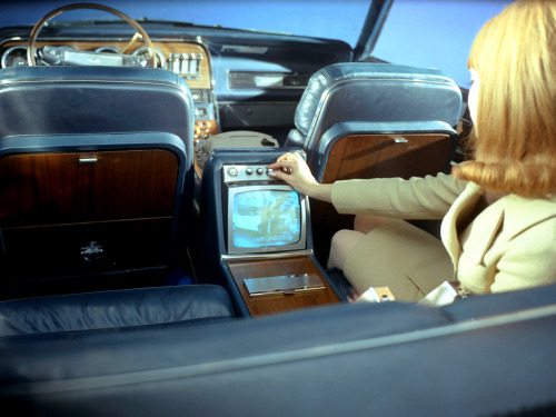 Wow, a TV in the back of a T-Bird convertible…