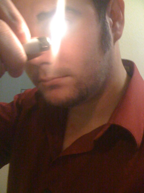 old pic of my face the lighter makes my eye look god-like gotta love it