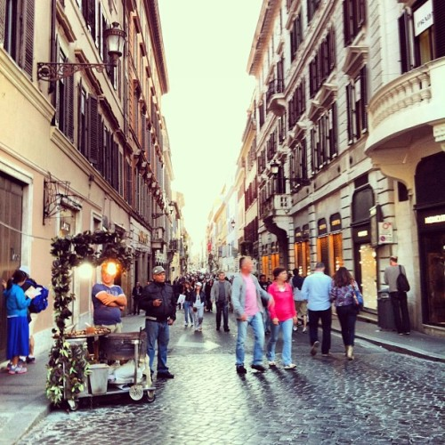 When in Rome #italy #rome #people #street #couple #city #sidewalk #shopping #store #cobblestone