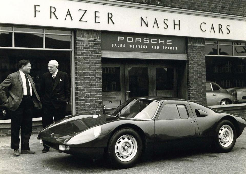 W H Aldington with Dickie Stoop taking delivery of his Porsche 904 GTS 904-045 outside AFN
