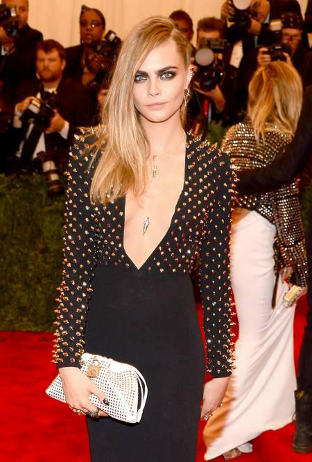 Cara Delevingne Best Dressed in Spiky Burberry LBD. at the Red Carpet of Costume Institute Gala for the 'PUNK: Chaos to Couture' exhibition at the Metropolitan Museum of Art 2013. May 7th, 2013 8:59  P.M. GMT.