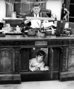 railways-and-roses:  JFK Jr under JFK's desk, 1963.