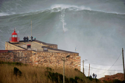 Garrett McNamara Road a Large Wave Yesterday Surfer Today is speculating that it's a hundred foot wave. Photograph by Tó Mané.