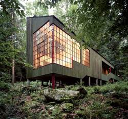"nirvikalpa:  Forest House, West Cornwall, Connecticut, 1976 — Peter Bohlin  Bohlin designed this narrow, green-stained wood house as a retreat for his parents. At the junction of a dark evergreen forest and a deciduous woodland, the building springs from a log-loading platform and floats over the forest floor. Carving around an existing boulder, explains Bohlin, the house demonstrates the value of accommodation and of ""doing this and that rather than just one thing."" The architect says the house is ""all about moving from dark to light"" and points to its circulation, which originates on the shaded edge and ends in a tall, illuminated space"