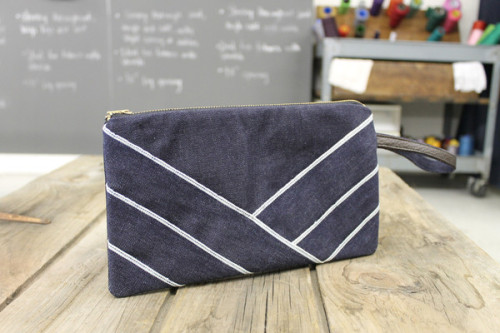 "Denim Clutch - Cone Denim Blue Selvedge Description  den.m bar's clutches utilize Kaihara denim from Japan and Cone Denim from North Carolina to create chic handbags for any occasion. The handles are adorned with leather and given a unique design quality with the signature den.m bar selvedge highlight. Material: Kaihara / Cone Denim Blue SelvedgeSelvedge HighlightLeather and denim handleDimension: 10"" x 6"" Shipping: Please allow 7-10 business days from purchase date for delivery.  Returns: If you are dissatisfied at any time during the first 30 days after purchase, simply contact us at info@denmbar.com for a RMA# and return the item in new condition to us.  All our products come with a 30 day money back guarantee."