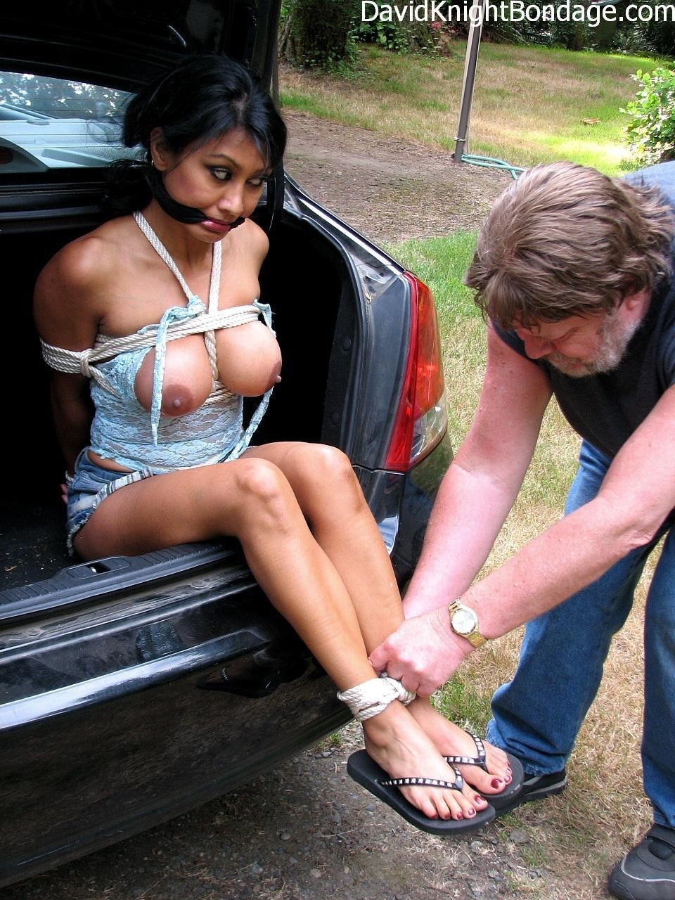 slaveauctions:  The slaver wanted to make sure his newest girl wasn't going to get away. Once the knots were tightened she was pushed into the trunk and driven to the auction.