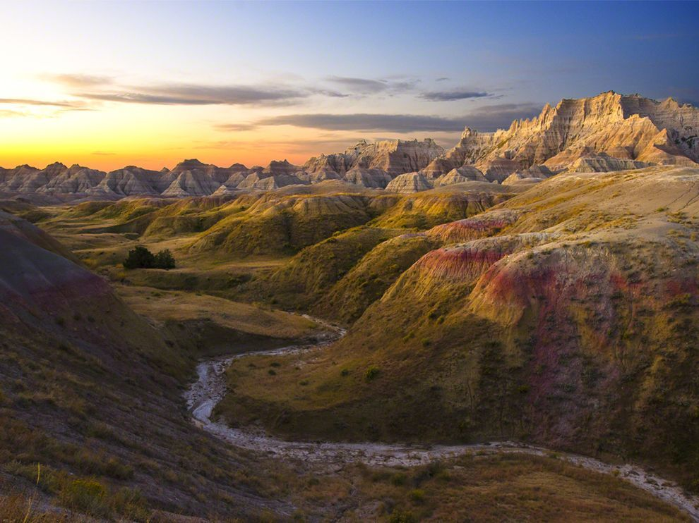 nationalgeographicdaily:  Sunrise, Badlands National ParkPhoto: Dan Dady