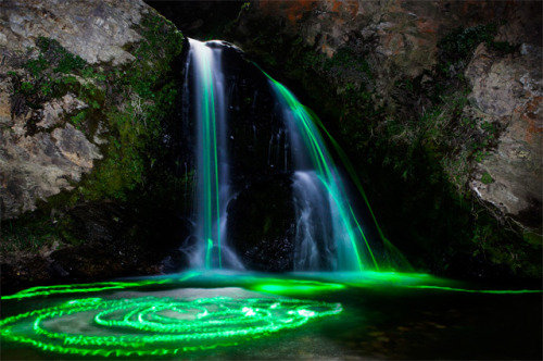 "skeletales:  A superb photographic series ""Neon Waterfalls"" from Sean Lenz and Kristoffer Abildgaard who placed in cascades and waterfalls in California glow sticks. A brilliant use of the long exposure to capture the universe and light."