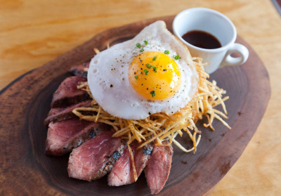tedgreek:  paris87:   flank steak with fried duck egg, matchstick potatoes, and crown royal whiskey sauce  FUCK.  I WANT!  Great way to fuck up a steak with bird period. Probably got a lettuce wedge to start.