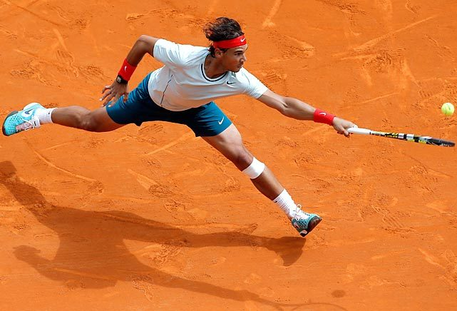 Rafael Nadal stretches for a return against Jo-Wilfried Tsonga during their semifinal match at the Monte Carlo Masters on Saturday. (Lionel Cironneau via Leading Off: Pictures of the Week - Photos - SI.com)