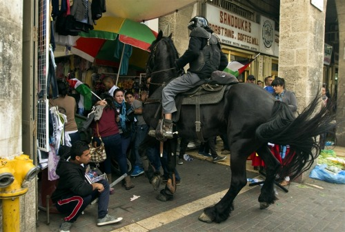 "fuckyeahmarxismleninism:  A mounted Israeli cop attacks Palestinian protesters as demonstrators gathered outside Damascus gate in Jerusalem (occupied Al-Quds) on May 15, to mark the 65th Nakba or ""Day of Catastrophe."""