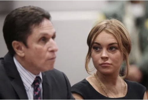 "Surprise, surprise. Lindsay Lohan is reportedly ""desperate"" to hire a new lawyer and fire the lawyer she JUST hired. This should turn out well…"