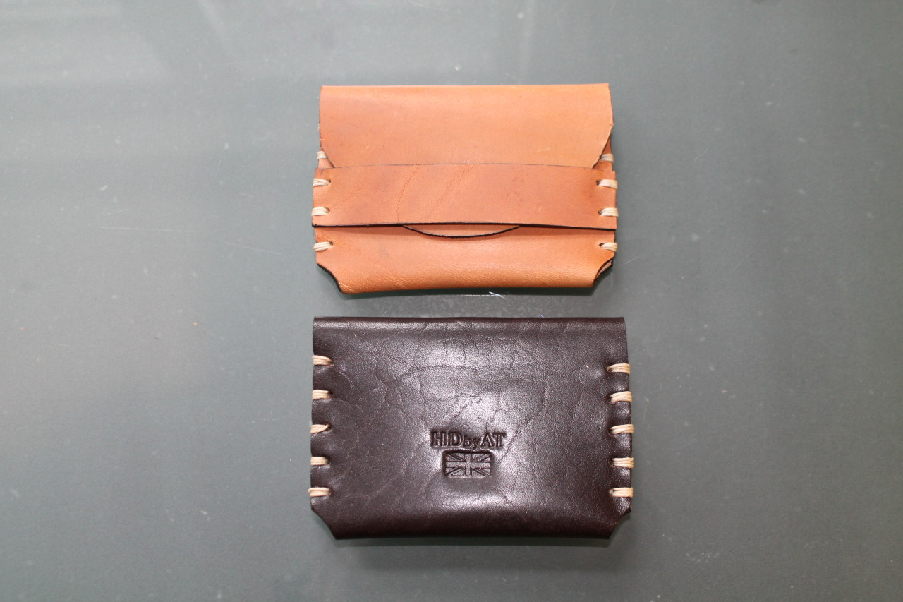 This is our micro wallet, small compact with two compartments to fit cash and cards. We have finished stitched with Londonderry Irish Linen thread to match the stitching of our belts. Again as you would expect from us it's all hand cut edged and stitched.  Available in six colour priced at £69.50 please contact us for details at hdbyatltd@gmail.com
