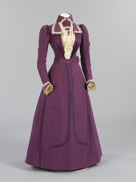 inspiringdresses:   Harriett Sams' Wedding Dress, 1899, BritishV&A Museum  This crisply tailored purple silk dress was made and worn by Harriett Joyce for her marriage to Percy Raven Sams at St Andrew's Church, Earlsfield, Middlesex. Harriett worked as a lady's maid, while Percy worked for the London Water Board. Harriett chose to wear purple, as at 35, she considered herself too old for a traditional white gown. However, she trimmed her hat with wax orange-blossom, which was worn by brides for their first marriage. The availability of sewing machines, commercially printed dress patterns and affordable but good-quality machine-woven silks and trimmings enabled skilled needlewomen to make sophisticated gowns at home like this dress. As a lady's maid, Harriett had excellent sewing skills, enabling her to finish her dress to a very high standard. A coloured day dress that could be worn for best after the ceremony was an extremely practical option for brides of limited means. Soon after the wedding, Harriett slightly altered the skirt, removing two side panels to create a narrower, more fashionable silhouette. She also added purple silk braid to the skirt-front so it could be worn separately with a blouse.