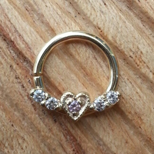 The Flying Heart ring is back in stock here at [Born This Way Body Arts - Knoxville, TN]! Made from solid 14k Yellow gold with hand-set gems by @bvla!