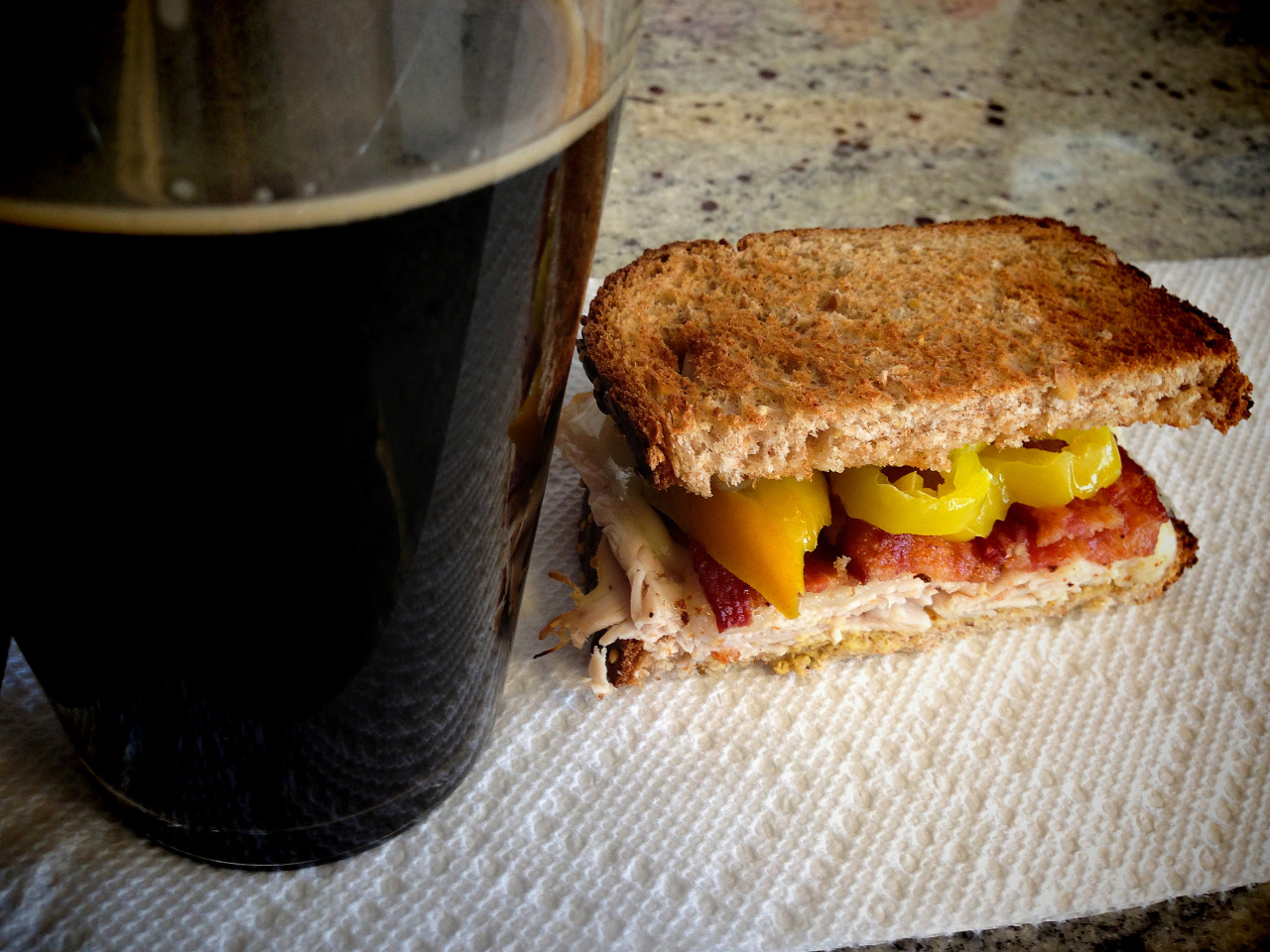 Ames Homebrew Milk Stout with a honey-glazed turkey and bacon sandwich with mustard, mayo, and hot banana peppers