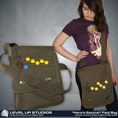 pwnlove:  Musical Hero's Bag Break out the ocarina, Wind Waker, harp or flute to play your favorite Legend of Zelda tune off these new messenger bags from Level Up Studios. Each messenger bag comes with ten rubber song note pins so you can compose your favorite song on the embroidered musical score on the flap.  I found this YouTube playlist of all the Ocarina of Time songs and I'm obsessed. I've been listening to it non-stop. It's fun to relive in-game memories and my productivity skyrockets whenever I listen to it.   I will standby that Song of Storms is the best Legend of Zelda song followed closely by the Legend of Zelda Opening Theme. What's your favorite Zelda song?  Hero's Bag ($37.99) & Hero's Satchel ($32.99) from Level Up Studios