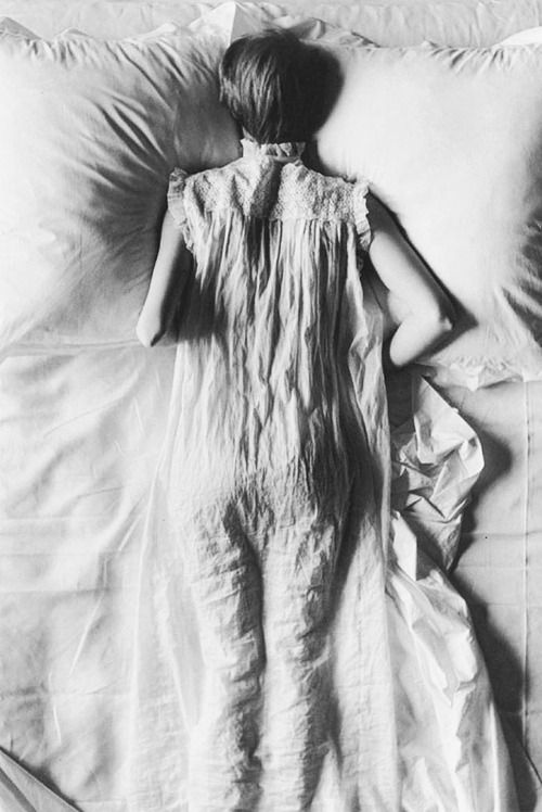 Jean Patchett, 1949. Photo by Irving Penn  The girl's nightgown and sheets are so closely related that its like she is stuck to her bed or one with her bed and not with reality….