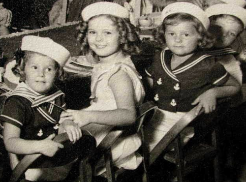 Shirley Temple at a nautically themed party, the girls either side of her are children of Darryl F. Zanuck (the executive producer of 20th Century Fox), 1930s.