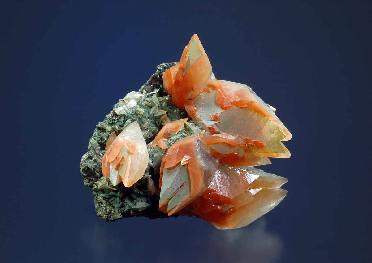 themineralogist:  Double-terminated, scalenohedral Calcite crystals with Hematite and Chlorite inclusions