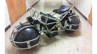 This spherical wheeled motorcycle was posted to Gizmodo with the comment-   Besides an eco-friendly electric drivetrain, the bike's spherical drive system is promised to be safer than a traditional motorcycle since the front wheel can't suddenly turn sideways and jackknife, leading to a crash. And those giant spherical wheels — made from carbon fibre and fibreglass covered in industrial rubber — make maneuvering and parking an absolute breeze since the bike can move sideways just as easily as it can move forwards and back.  I can't help but wonder though, if being able to careen sideways toward objects is any better even if you're rolling fluidly. Maybe I should ride it to find out.