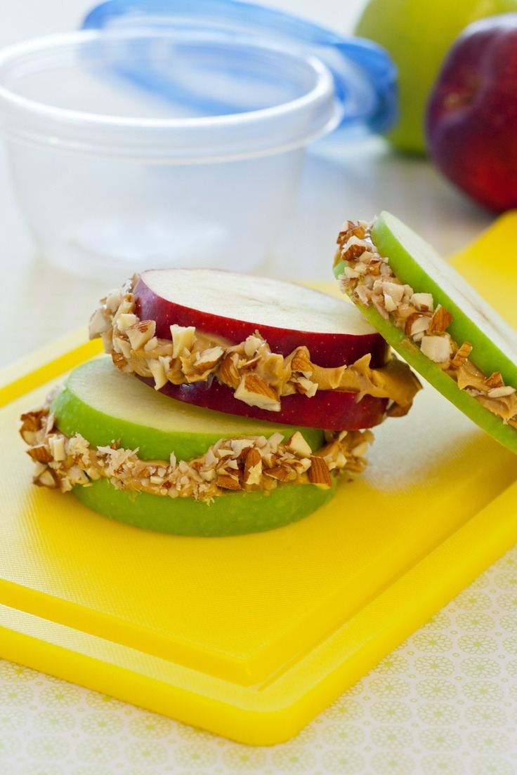 conflictingheart:  Mix granola and peanut butter, spread between two thick apple slices for a hearty, fruity sandwich.