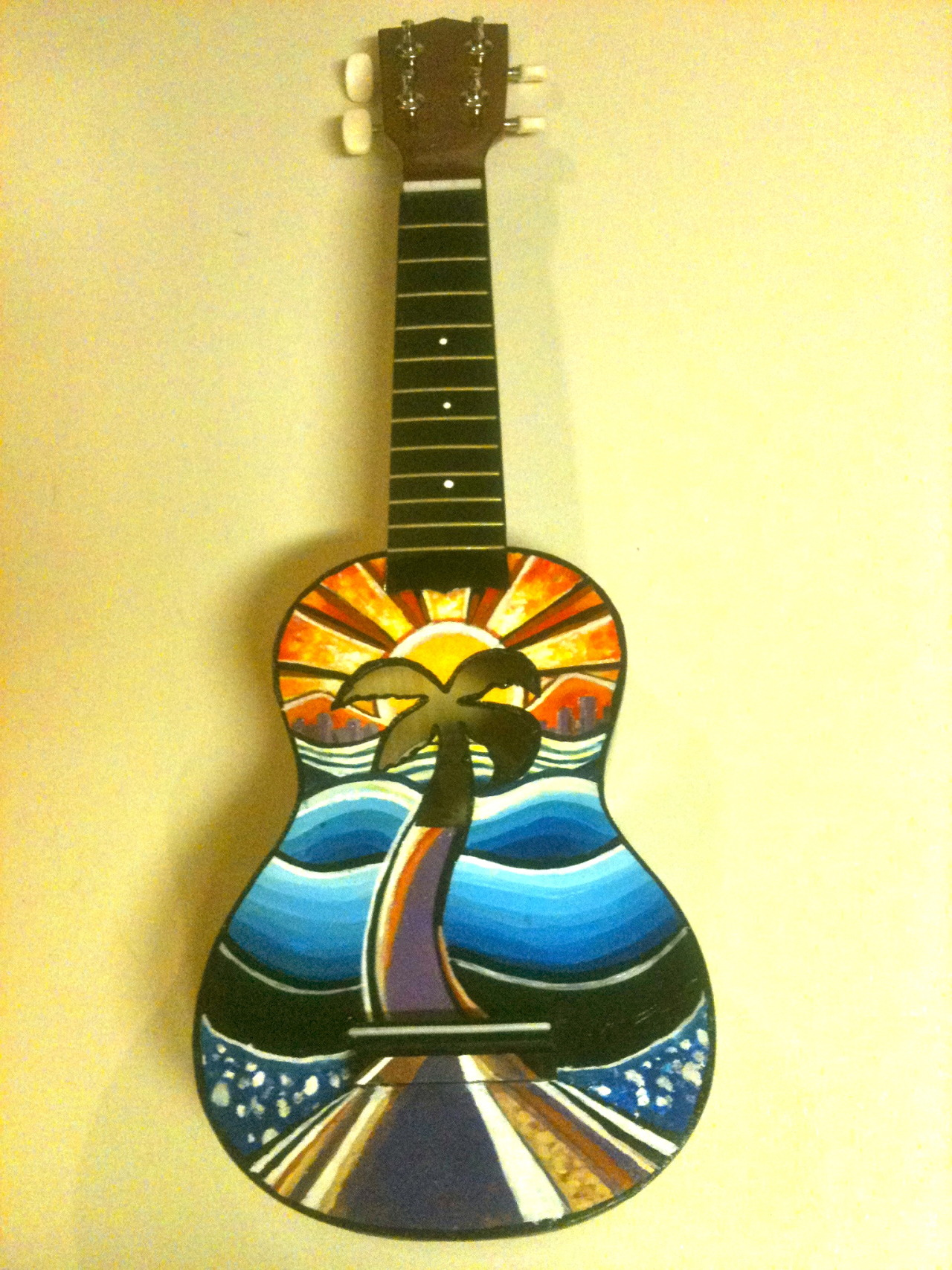 kimpossiblemusic:  finally handed off this painted ukulele to my homie steve. the only thing he wanted me to keep in mind when i was painting on it was to work with the design of the uke where the palm tree is the sound-hole. i'm proud of how it turned out and think it looks dope. cool assignment as always. i love steve cos he's always been a believer of my art which has led me to believe in my art more. since i was an undergrad, he's been getting me to do commissioned work for him. the very first work i did for him were Vancouver themed shoes and throughout the fabric i  drew main landmarks/buildings in vancouver. k!M
