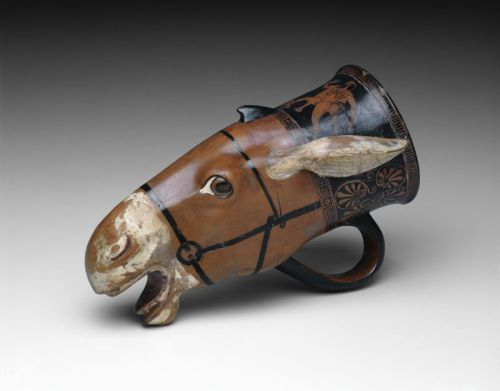 ancientpeoples:  Rhyton (Drinking Vessel) in the Shape of a Donkey Head c. 460 BC Greek, Attica This drinking cup could not have been set down without its contents spilling. It is fashioned after the head of a bridled donkey with a white muzzle, teeth, and ears. Like the naked satyr chasing a fleeing maenad on the vessel's neck, the donkey belongs to the retinue of the wine god Dionysos. Douris, one of the great Athenian vase painters of first half of the fifth century B.C., decorated this amusing cup. Source: The Art Institute of Chicago