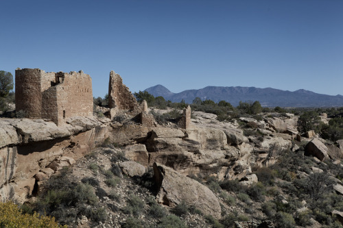 HOVENWEEP - COLORADO/UTAH BORDER  In an area of the United States where a 50 year old building is considered ancient history sits the Hovenweep National Monument.  Starting with the hunter-gatherers 10,000 years ago, this high desert outpost just an hour north of the Four Corners on the Colorado / Utah border, is a frequently overlooked treasure of the region's cryptic past. All too often, visits to the other major archaeological sites in the area like Chaco Canyon or Mesa Verde end up feeling like a trip to the mall with its accompanying crush of people and visual clutter of signs and rope fences.  Hovenweep, with an average of only 25,000 visitors each year, is the complete opposite.  It is a uniquely personal, remote and beautiful experience that is well worth the drive. Named for the Ute word for deserted valley, Hovenweep lives up to its name, sitting on the 30 mile long Cajon Mesa in the Great Sage Plain in near silence.   Standing out there it seems inconceivable that thousands of people once lived and farmed in such a harsh and, to us, remote place.   Starting around A.D. 500 ancestral Puebloans began settling in the area; by A.D. 900 they began living at Hovenweep.  The six villages that make up the monument were built starting around A.D. 1200 and ultimately abandoned by the end of the thirteenth century due to a combination of a 20 year drought, increased population, and hostilities in the area.  The ruins left behind are a conglomerate of unique architectural styles, many still standing on their own some 700 years later. Start at the visitors' center and the Square Tower complex behind it.  Keep in mind that at one time the sage plain that surrounds you had farm fields spread out over an area the size of 300 city blocks in every direction, and you will begin to understand the enormity and complexity of what was once a very busy place. Stay at the 31-site campground near the visitors' center and explore all six ruins, or spend a few days and take in some of the adjacent Canyons of the Ancients National Monument's 176,056 acres and 6,000 recorded archeological sites. Guide Note: Hovenweep at National Park Service website * * *  At-Large Guide to the West James Orndorf was born in Minnesota, but knew at a very young age that the future lay out west. He is currently photographing and illustrating outside of Durango, Colorado. You can see what he's up to at inlandwest.tumblr.com and roughshelter.com.