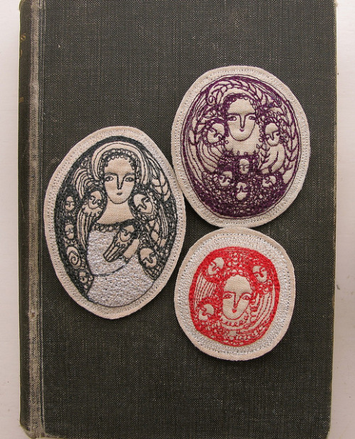 three brooches