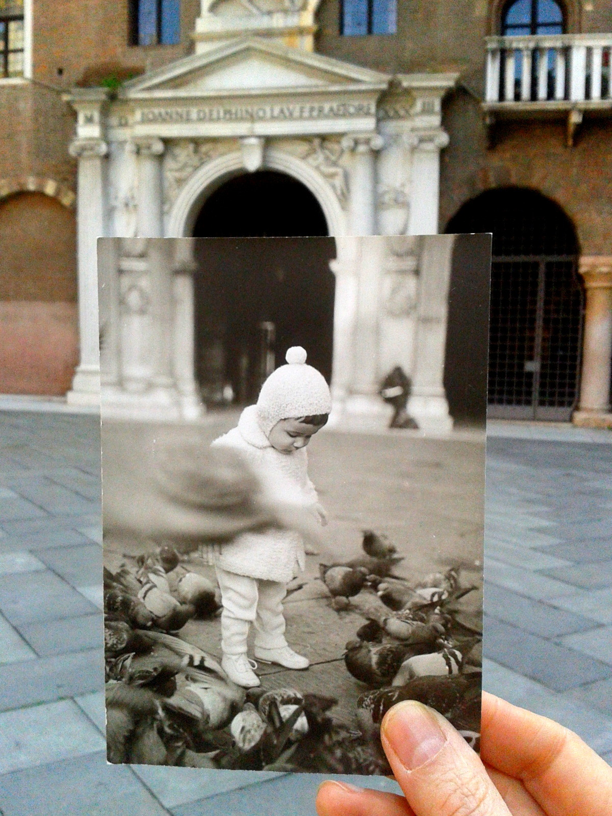 Dear Photograph,This is me in the far 1962. I was in Piazza dei Signori (Lord's Square) in Verona, Italy. I was giving corn seeds to the pigeons. Now it's forbidden…Annalisa