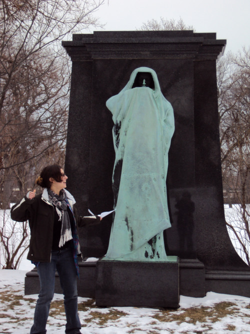 Statue of Death at Graceland Cemetery (along with a creeped out Caroline) oh hey you can see my reflection on the limestone. such a creepy ass statue.