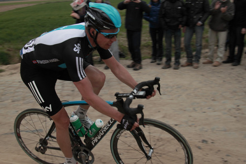 Edvald Boasson Hagen | Paris-Roubaix 2012 on Flickr.Via Flickr: Paris–Roubaix is a one-day professional bicycle road race in northern France near the Belgian frontier. From its beginning in 1896 until 1967 it started in Paris and ended in Roubaix (hence the name); since 1968 the start city has been Compiègne (about 60 kilometres (37 mi) north-east from Paris center) whilst the finish is still in Roubaix. Famous for rough terrain and cobblestones (setts),[n 1] it is one of the 'Monuments' or Classics of the European calendar, and contributes points towards the UCI World Ranking. It has been called the Hell of the North, a Sunday in Hell (also the title of a film about the 1976 edition of the race), the Queen of the Classics or la Pascale: the Easter race.[1] The race is organised by the media group Amaury Sport Organisation annually in mid-April. First run in 1896, Paris–Roubaix is one of cycling's oldest races. It is well known for the many 'cobbled sectors' over which it runs, being considered, along with the Ronde van Vlaanderen and Gent–Wevelgem to be one of the cobbled classics. Since 1977, the winner of Paris–Roubaix has received a sett (cobble stone) as part of his prize.[2] In recent years, the terrain over which Paris–Roubaix runs has led to specialized bikes, with unique frames and wheels, being used. Wheel punctures and other mechanical problems are extremely common because of this terrain, and often play a part in who is able to ultimately make it to Roubaix with momentum. Despite the high esteem with which the race is seen, some notable cyclists throughout history have regarded the race as a joke because of its difficult conditions. The race has also seen several controversies over the years, with many seeming winners of the race disqualified for various reasons. The course is maintained by Les Amis de Paris–Roubaix, a group of fans of the race formed in 1983. The forçats du pavé seek to keep the course as safe as possible for riders while maintaining its difficulty.