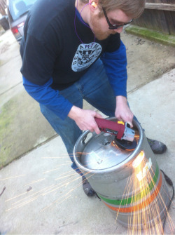 deptawesomebeer:  #keggle cutting the top off this old #keg with an angle grinder Remember Safety third. #homebrew #awesome #beer #microbrew