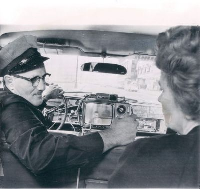 Flash Cabs install televisions in their taxis, 1963, Chicago.