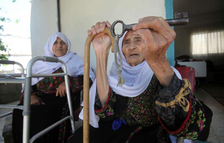 fuckyeahmarxismleninism:  A 102-year-old Palestinian woman holds the key of her family home in the village of Iraq al-Manshiyya, in what is now Israeli-occupied Palestine, on May 14, 2013. She now lives in al-Aroub Palestinian refugee camp, just north the West Bank town of Hebron.