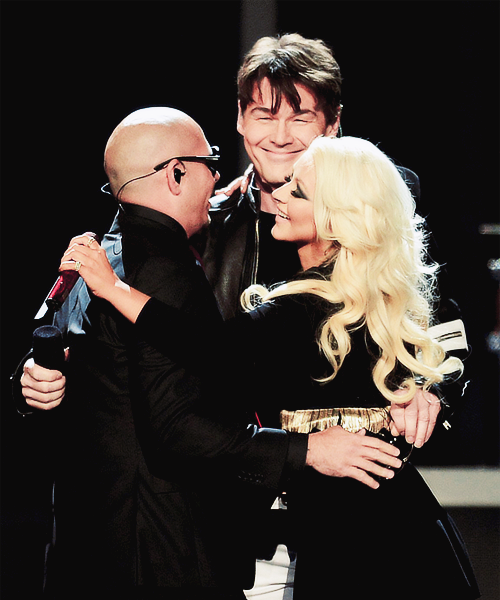 Recording Artists Pitbull, Morten Harket of A-ha and Christina Aguilera perform onstage during the 2013 Billboard Music Awards at the MGM Grand Garden Arena on May 19, 2013 in Las Vegas, Nevada.