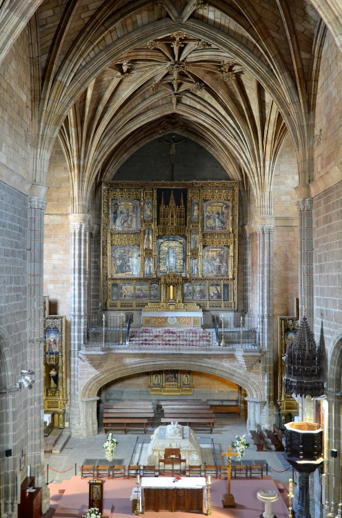 Choir of the Real Monasterio de Santo Tomas, with its splendid altar and reredos painted by Pedro Berruguete in Avila, Spain. Also visible is the tomb of Juan, Prince of the Asturias, and only son of Isabela I and Ferdinand II, by Domenico Fancelli.