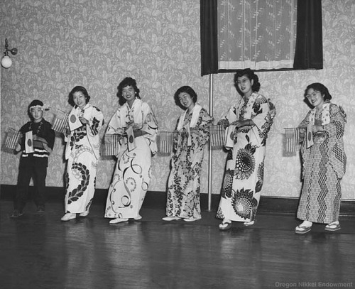 Odori Dancers Photo (taken by Frank C. Hirahara) of members of the Oregon Buddhist Church and Epworth United Methodist Church of Portland, circa 1948-54. They are all holding American and Japanese flags, but the occasion is unknown. Left to right: Ed Tamiyasu, Alice Kida, Jean (Tsujimura) Takashima, Jean (Kida) Tomita, Shizuko (Ochiai) Okazaki, Alice (Matsumoto) Ando.