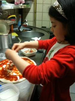 She wanted pizza so I told her to help me make it :3 little hungry bug