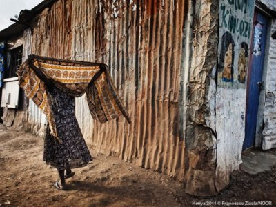"Kenya: Escaping death in Africa's largest urban slum ""When I came to Kibera for the first time I felt humbled by what I saw. It was hard for me to imagine that it was possible to live in such conditions: in Kibera, an estimated 250,000 people live on a five-square-kilometre patch of land. They live in very small houses made of mud or iron sheeting.  MSF Clinical officer, Kelly Khabala, recounts his work treating people in Kibera, Africa's largest urban slum in the Kenyan capital of Nairobi. Dust and smoke, stench, sewage, waste, and water shortages are common and leave their mark on people's everyday lives. There are not enough latrines, and if you want to use a toilet, you have to pay five shillings. Some families cannot afford this, and as a result use plastic bags, which in turn are thrown along the narrow paths of the slum."