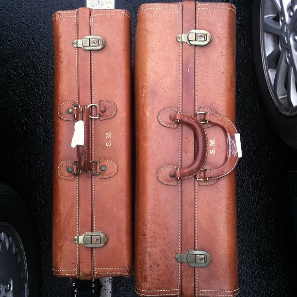 stylepurveyor:  vintage #hartmann suitcases…a bit above my budget, but couldnt pass up #hartmann  Excerpt - Nomad: Packing Up I spent most of the day with my eyes closed, sitting on the bed, trying to focus on anything I could about Mark Winter. I had never encountered someone I could not read, though clearly Mark was unlike all the humans I had spent my time with for the last three years. I could always sense my family, though, so why couldn't I sense Mark? After he walked out the door of my penthouse, it was as if he'd evaporated. I needed to be able to see inside his mind because, despite his warnings, I planned to track him. First, I would tell my family of his existence, and then I hoped to provide them with his whereabouts. Then I would go, my part in this ended. But I had to find a way to sense him first. In the meantime, I got ready for my journey. I had to pack everything I owned, which was not quite the feat it would be for a typical person. Despite using Nashville as home base for some time, I was still a nomad. I didn't travel as lightly as the typical nomad, true, but I could fit everything I owned into a large set of Hartmann luggage that fit in my car. I had never had the desire to stay in one place, and I had used up the resources in Nashville, so it was time to move on. Now that Corrina was gone, I had no ties here. The next morning I gathered all my things and called for a bellman. I took the elevator down to the lobby and asked a young girl behind the desk to get the general manager so I could speak with her. I explained that it was time for me to leave, and assured her that they had done all they could have to make this hotel feel like home to me. I meant every word I said. She shook my hand and thanked me graciously for my patronage. She inscribed her private cell phone number on a business card and encouraged me to use it should I need anything. I handed her a stack of sealed envelopes, each marked with a hotel employee's name. I had made a mental map of everyone I had met here, and I put at least a $50 bill into each envelope, along with a thank you. For those I perceived needed or deserved more, I threw in a little extra.
