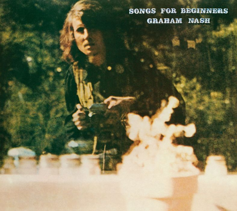 Graham Nash's self-portrait on this album covers shows him holding a 35mm SLR. It's difficult to tell just what it is. Any guesses?