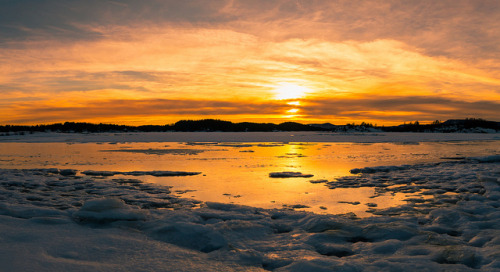 Sunset reflection on the ice by spookst on Flickr.