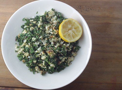 Roasted Cauliflower & Steamed Kale Salad1 small head of Cauliflower, broken into florets3 cups raw Kale, large stems removes, leaves chopped small2 tbsp Extra Virgin Olive OilJuice from half of a LemonSalt & Pepper to taste Toasted Sesame Seeds (optional)  Preheat oven to 350.  On a baking sheet, toss florets in olive oil and season with salt and pepper.  Roast in the oven for 15-20 minutes until cauliflower is soft and begins to brown (toss about halfway through to brown on different sides).  Fill a soup pot or large sauce pan with an inch or two of water and place over medium/high heat.  Place a vegetable steamer in the pot and add the kale.  Steam the kale until tender.  Remove cauliflower from oven and let cool until you can handle it.  Chop up cauliflower into very small pieces.  In a bowl, toss with steamed kale and season with salt and pepper.  Add to a serving bowl and squeeze fresh lemon juice over the top. Sprinkle with sesame seeds. Can be served warm or room temperature.   Hey! Like The Bored Vegetarian on Facebook!