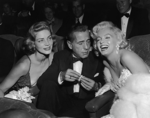 Humphrey Bogart, Lauren Bacall, and Marilyn Monroe at the premiere of How to Marry a Millionaire (1953)